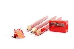 Wenige Bleistifte mit Bleistiftspitzer Lizenzfreie Stockfotos