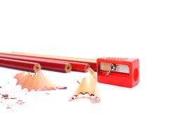 Wenige Bleistifte mit Bleistiftspitzer Lizenzfreie Stockfotografie