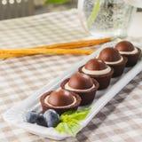 Wenige chokolate Kuchen Lizenzfreie Stockbilder