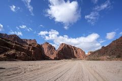 Blue sky white clouds and colorful Wensu Grand Canyon in Autumn. Wensu Grand Canyon in Wensu County, Northwest China`s Xinjiang Uygur Autonomous Region, is a royalty free stock image