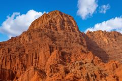 Blue sky white clouds and colorful Wensu Grand Canyon in Autumn. Wensu Grand Canyon in Wensu County, Northwest China`s Xinjiang Uygur Autonomous Region, is a stock photos