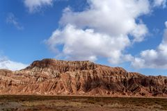 Blue sky white clouds and colorful Wensu Grand Canyon in Autumn. Wensu Grand Canyon in Wensu County, Northwest China`s Xinjiang Uygur Autonomous Region, is a royalty free stock photos