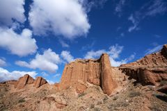 Blue sky white clouds and colorful Wensu Grand Canyon in Autumn. Wensu Grand Canyon in Wensu County, Northwest China`s Xinjiang Uygur Autonomous Region, is a royalty free stock photography