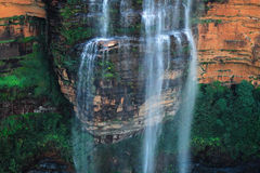 Wentworth Falls Ledge. Wentworth Falls in the Blue Mountains of New South Wales, Australia. The water briefly stops as it hits this ledge, slowly trickles Royalty Free Stock Photos
