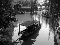 Wuzhen Boat Willow Tree. It lies within the triangle formed by Hangzhou, Suzhou and Shanghai. Covering an area of 71.19 km2 (27.49 sq mi), Wuzhen has a royalty free stock photography