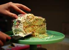 Wer wünscht eine andere Scheibe des Kuchens? Stockbild