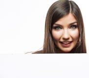 Werbungsanschlagtafel der Geschäftsfrau-Gesichtsblicke heraus Stockbild