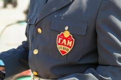 Werden Sie mit einer Aufschrift von GAI des Polizeibeamten deutlich Stockfotos