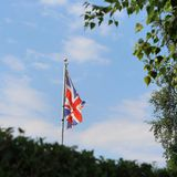 Were in england. Flag blowing in summer Stock Photo