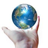 Wereld in handen Stock Foto