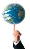 Wereld op een menselijke vinger royalty-vrije stock foto