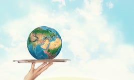 Wereld op zilveren schotel Stock Foto
