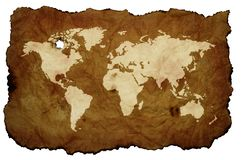 Wereldkaart op oud vergeeld perkament stock illustratie