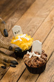 Werewolf hand reaching for a Halloween cupcake top view Royalty Free Stock Photos