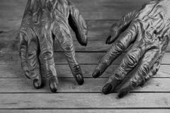 Werewolf hands for Halloween in black and white. Werewolf hands on a rustic wooden background for Halloween Stock Photography