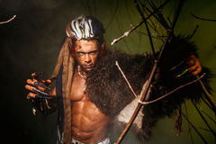 Werewolf with a skin on his shoulder and long nails among tree b. Ranches royalty free stock image