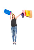 Werfende Einkaufstaschen der frohen Einkaufsfrau Lizenzfreie Stockfotografie