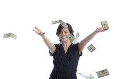Werfendes Geld der jungen Latina-Frau Stockfotografie