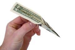 Werfendes Geld weg Stockfoto