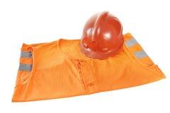 Werkend helder oranje vest en een helm royalty-vrije stock fotografie