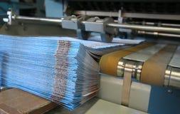 Werkende af:drukken machine stock afbeelding