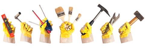 Werkende handschoenen met hulpmiddelen Stock Afbeeldingen