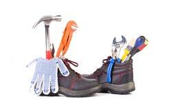 Werkende hulpmiddelen in laarzen Royalty-vrije Stock Afbeeldingen