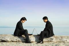 Werkende zakenlieden Stock Foto's