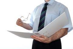 Werkende zakenman met dossieromslag Stock Afbeelding