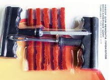 Werkzeug für Reifenreparatur Stockfoto