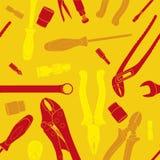 Werkzeuge des roten und gelben Musters Stockfoto