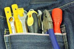Werkzeuge in einer blauen Baumwollstofftasche Lizenzfreies Stockfoto