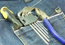 Werkzeuge in einer blauen Baumwollstofftasche Stockfotos