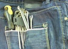 Werkzeuge in einer blauen Baumwollstofftasche Lizenzfreie Stockfotos