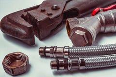 Werkzeuge für Reparatur der Klempnerarbeit stockbilder
