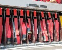 Werkzeuge weg abzufeuern von den Feuerwehrmännern, Lizenzfreie Stockbilder