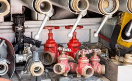 Werkzeuge weg abzufeuern von den Feuerwehrmännern, Stockbild