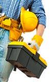 Werkzeugkasten in der Hand der Arbeitskraft Stockfoto