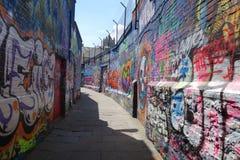 Werregarenstraat Gant. A small street in Gant full of colored graffiti Stock Images