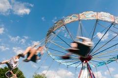 Wervelende carrousel Stock Foto's