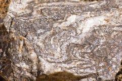 Wervelende mineralen in een rots Stock Afbeelding