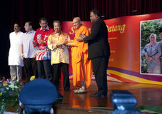 Wesak day Celebration. KUALA LUMPUR, MALAYSIA, May 17, 2011 : Deputy prime minister, Tan Sri Muhyiddin Yasin received a gift from the chief priest of the temple Royalty Free Stock Photo