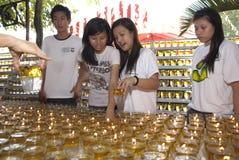 Wesak day volunteer. Kuala Lumpur, May 17 : A volunteer light candle on the Wesak Day celebration at Buddhist temple May 17, 2011 in Kuala Lumpur, Malaysia Royalty Free Stock Photo