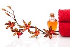 Wesentliche Schmieröle, Tücher und Orchidee Lizenzfreie Stockfotografie