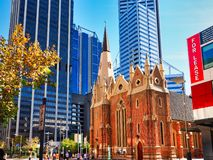 Wesley Uniting Church, Perth, Western Australia. The small red brick Wesley Uniting Church in the Perth CBD, Western Australia, with high rise modern office stock images