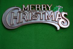 Wesoło boże narodzenia na zielonym tle Fotografia Royalty Free