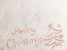 Wesoło boże narodzenia pisać na białym śniegu Fotografia Royalty Free