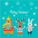 Wesoło boże narodzenia, zwierzęta, niedźwiedź jest ubranym pulower z płatkami śniegu, królik, rogacz z światłami i królik, Obrazy Royalty Free