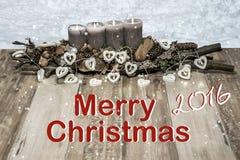 Wesoło bożych narodzeń dekoraci palenia popielatej świeczki wiadomości tekstowej śnieżni kierowi lampowi anglicy 2016 Obrazy Stock