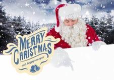 Wesoło bożych narodzeń powitania przeciw Santa Claus wskazuje na białym plakacie Obrazy Royalty Free